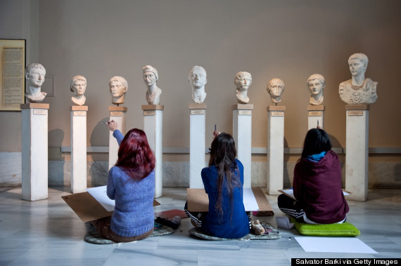 Students examining ancient sculptures, Museum Of Archeology, Istanbul, Turkey