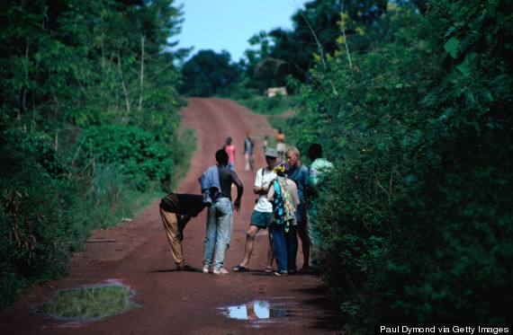 A group of tourists talking with locals on the road from Bangui to Kembe Falls.