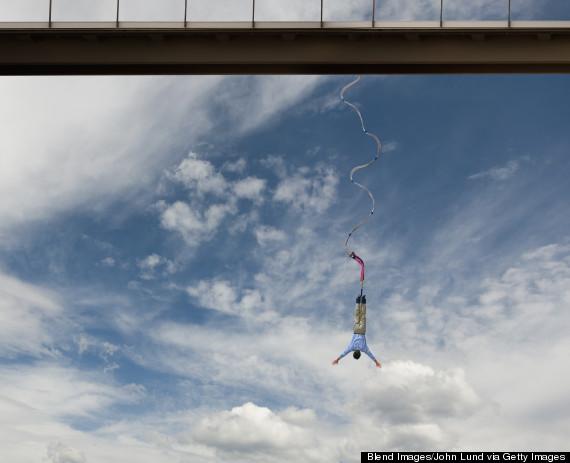 Hispanic man bungee jumping