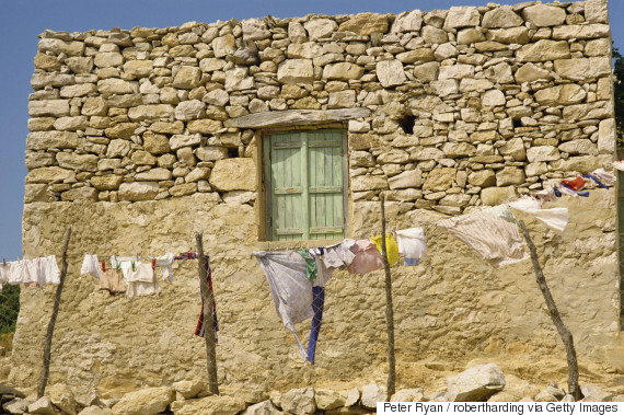 Washing line in front of an old stone wall with small window at Kastri on Gavdos, Greece, Europe