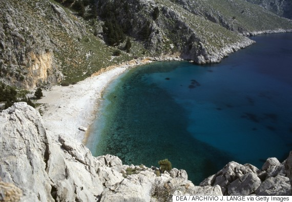 GREECE - JULY 24: A beach along a rocky stretch of coastline, Symi island, Greece. (Photo by DeAgostini/Getty Images)