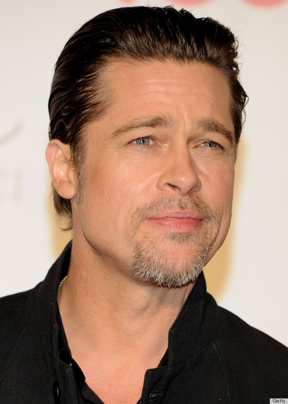 "MADRID, SPAIN - DECEMBER 16: Brad Pitt attends ""The Tourist premiere at Palacio de los Deportes on December 16, 2010 in Madrid, Spain. (Photo by Carlos Alvarez/Getty Images)"